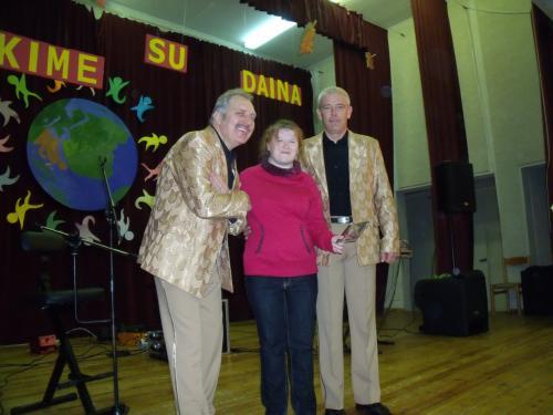 Sandra su muzikantais